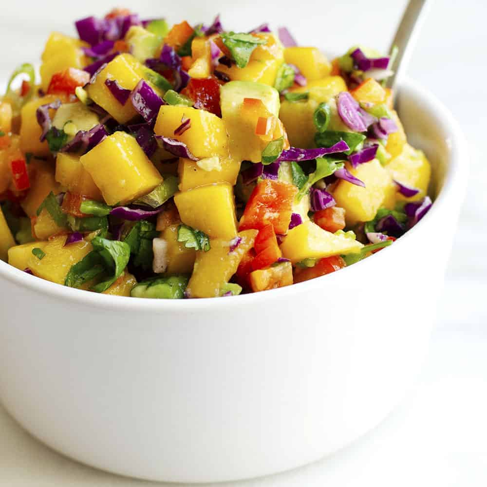 Mango Salsa served in a white bowl