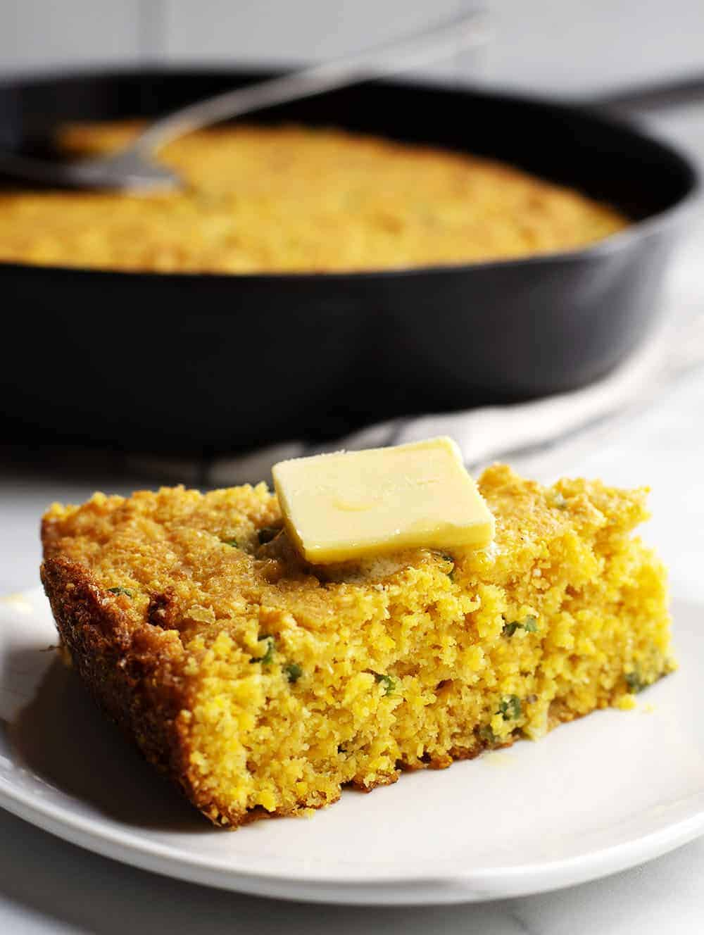mexican cornbread wedge served with butter on top