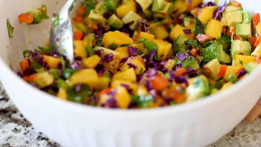 stirring mango salsa
