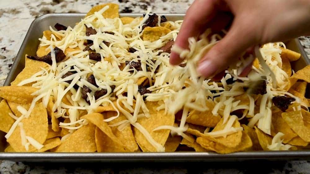 topping chips with shredded cheese