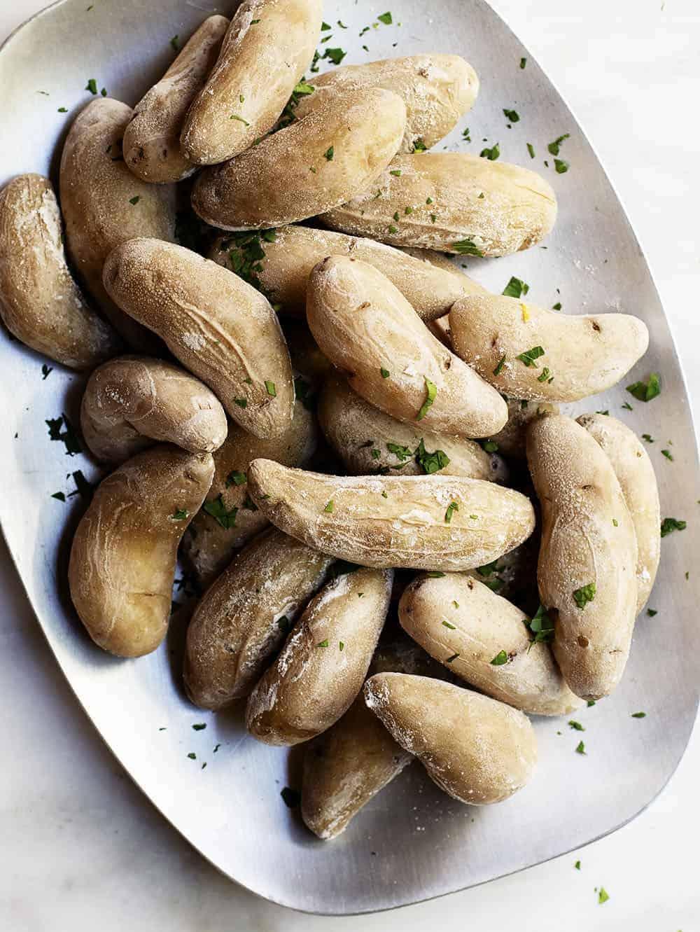 salt potatoes served on a brushed metal platter