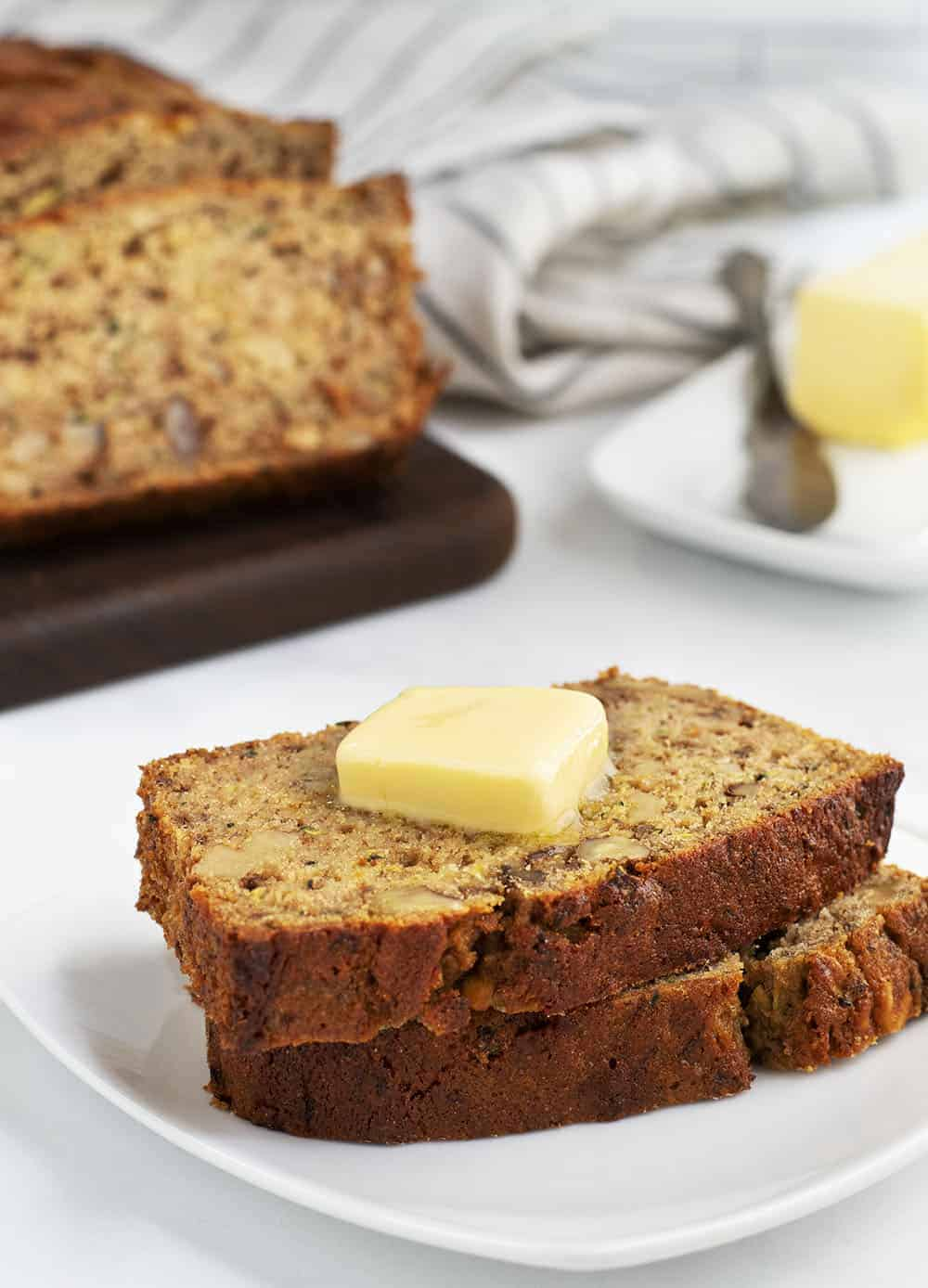 slices of zucchini banana bread served with butter