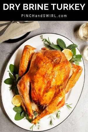 dry brine turkey served on a white oval platter
