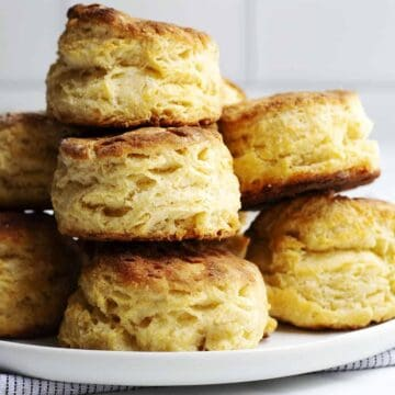 Homemade Biscuits stacked on a white plate