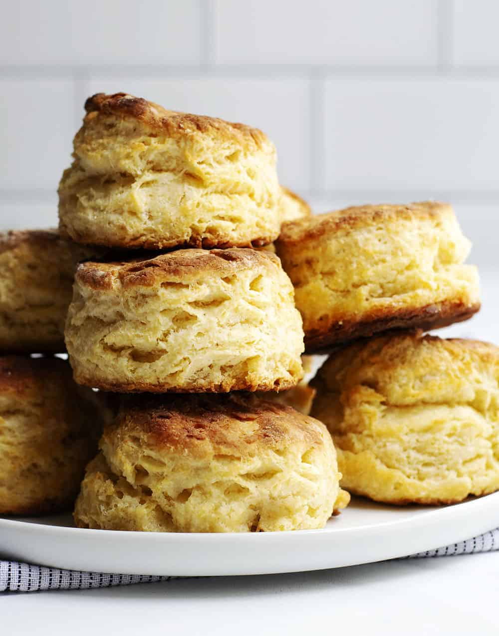 homemade biscuits stacked on a plate