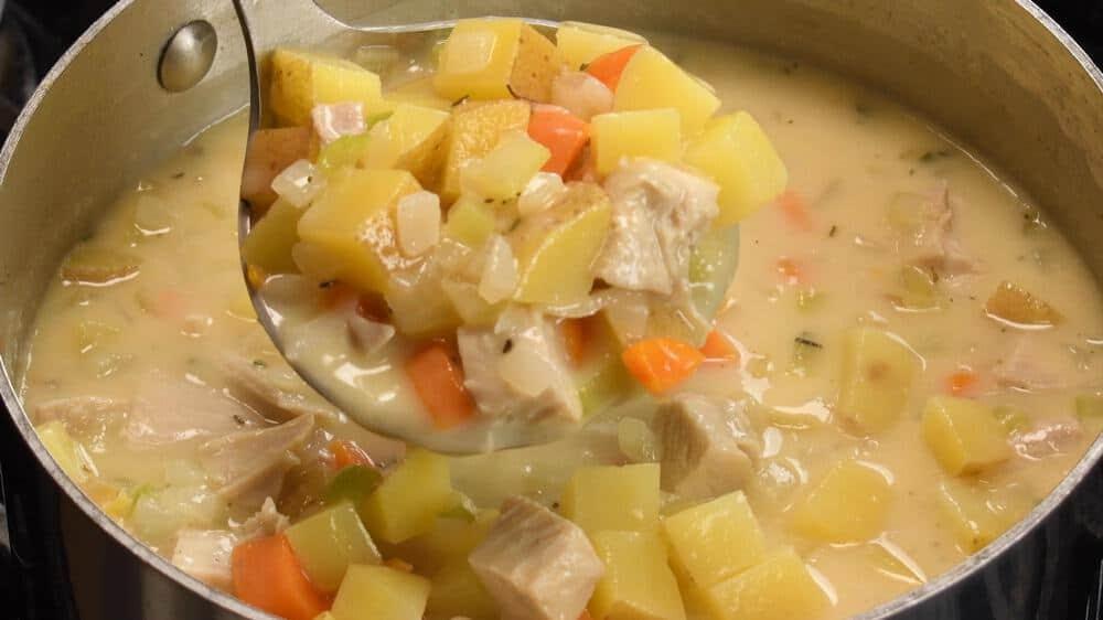 ladle of turkey pot pie soup