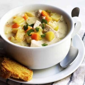 Turkey Pot Pie Soup served in a white bowl