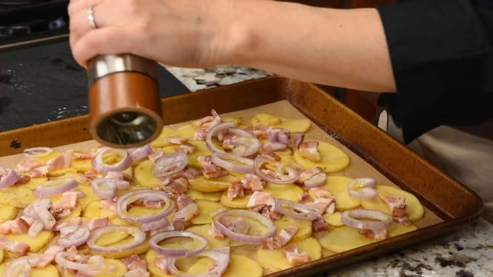sliced potatoes bacon and shallot ready to bake