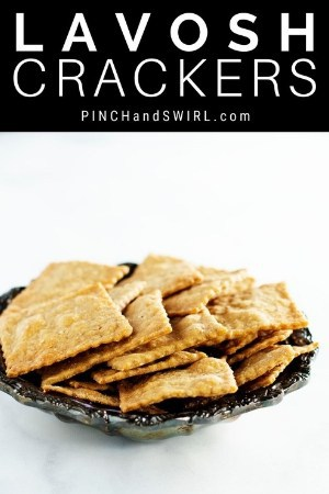 lavosh crackers stacked in a sliver bowl
