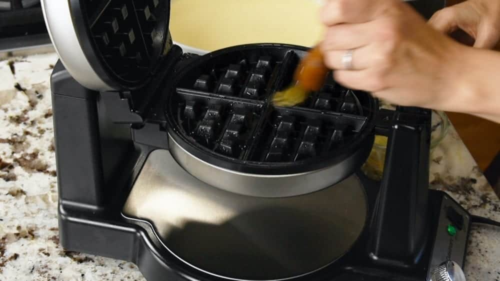 brushing waffle iron with oil