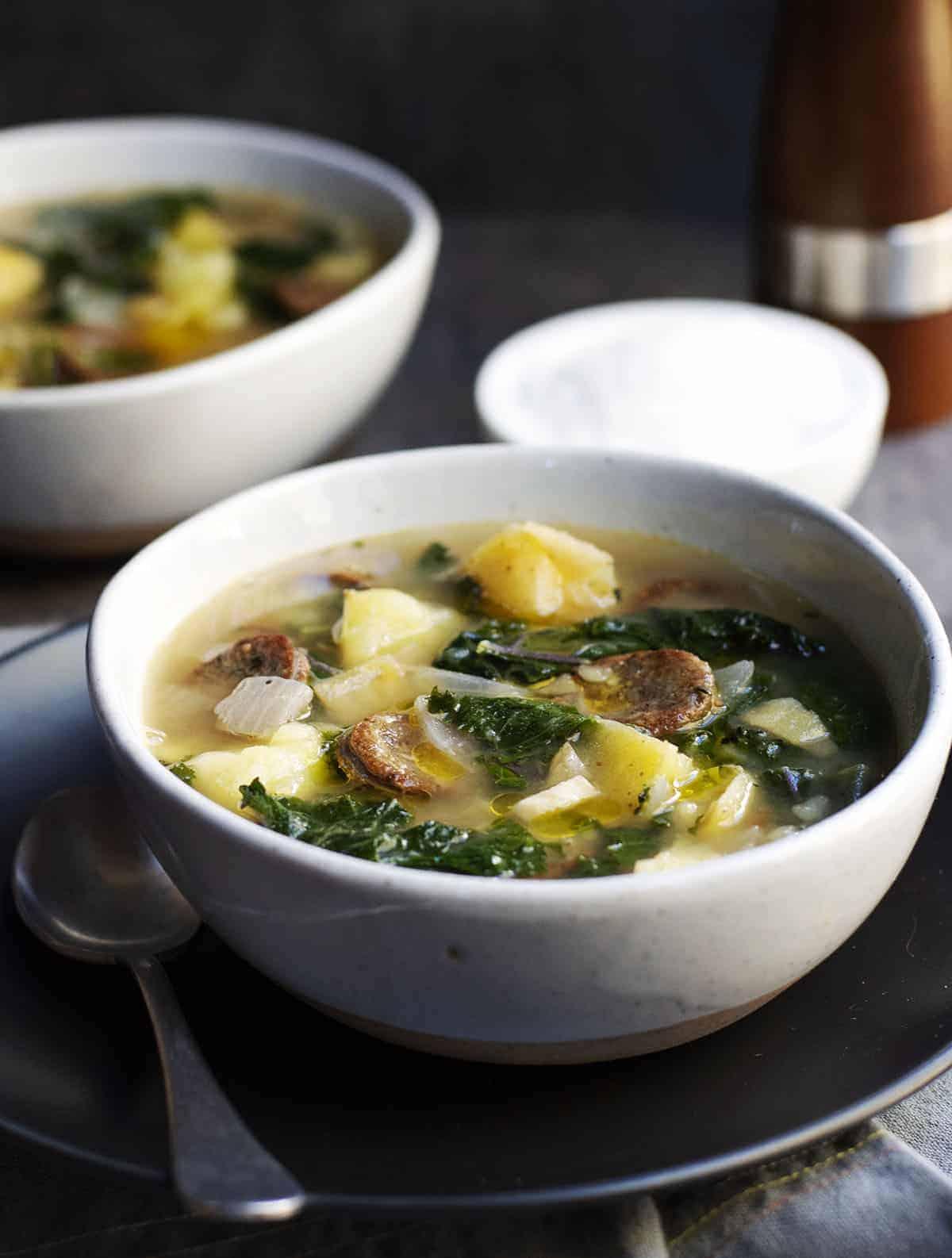 caldo verde served in ceramic bowls