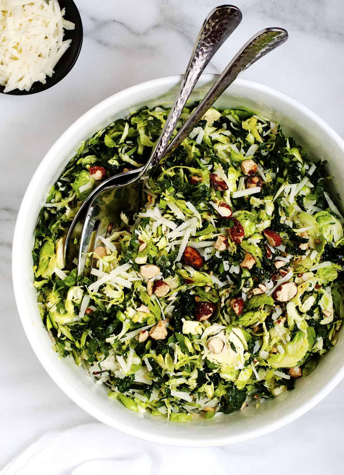Kale and Brussels Sprout Salad served in a white bowl