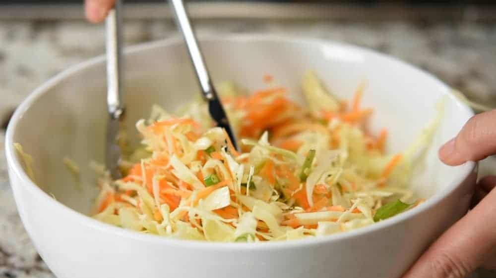 tossing curtido slaw
