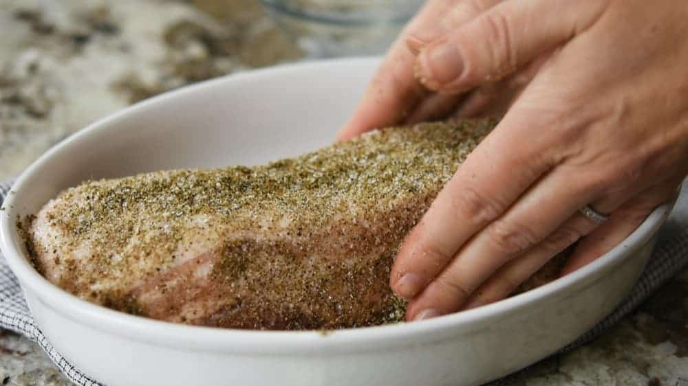 coating pork belly with spice mixture