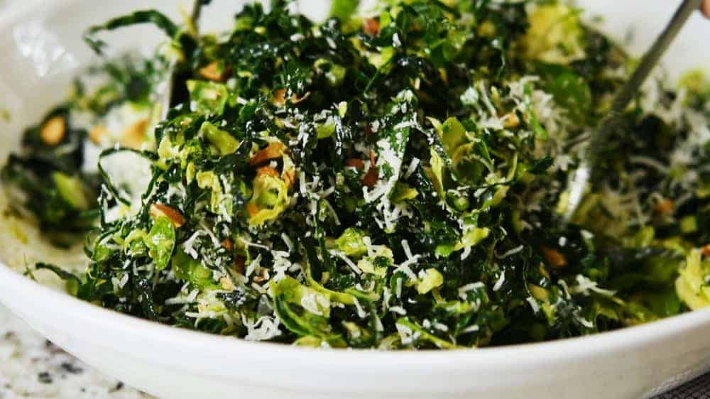 tossing kale and brussels sprout salad