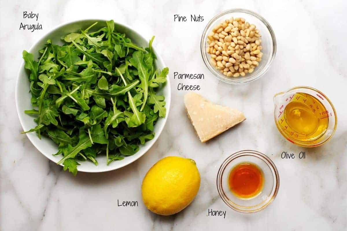 Arugula Salad Ingredients on a white marble board