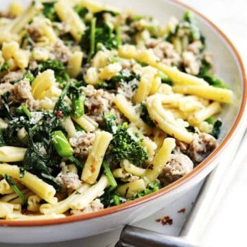 Broccoli Rabe and Sausage Pasta served in a white bowl