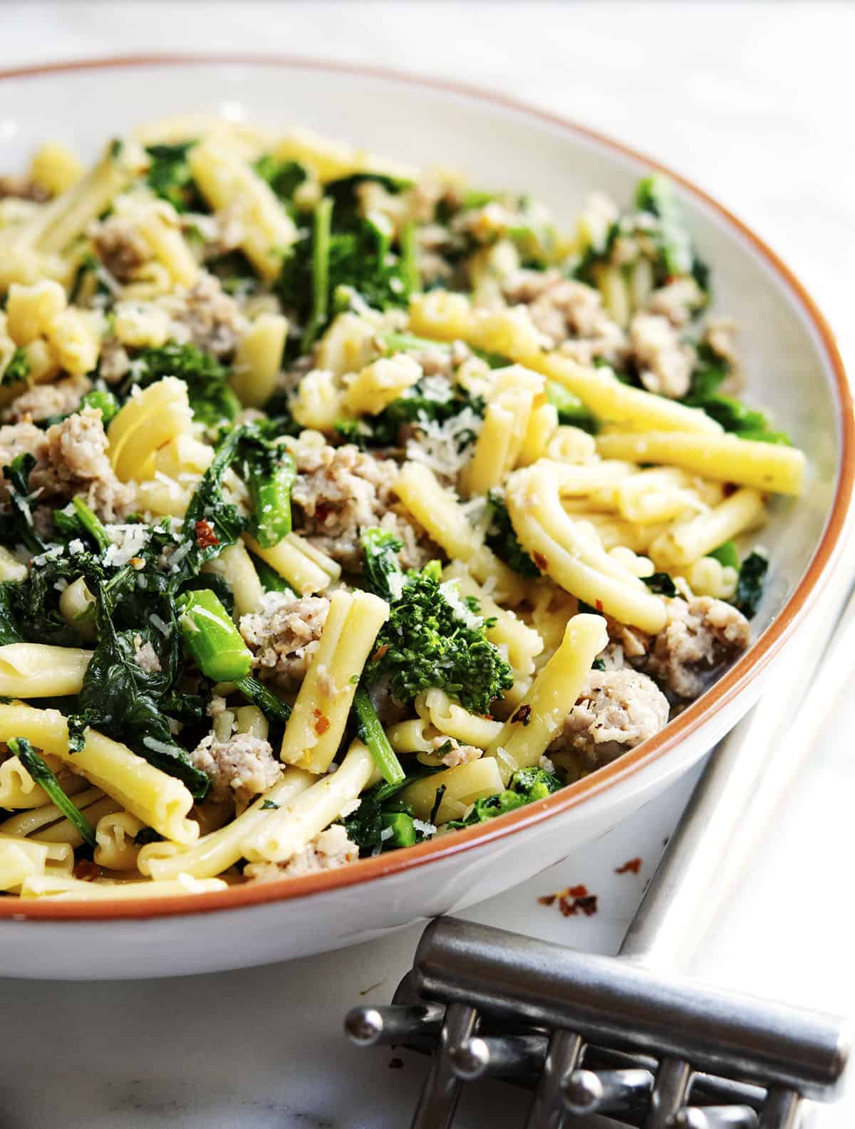 Broccoli Rabe and Sausage Pasta served in a white ceramic bowl