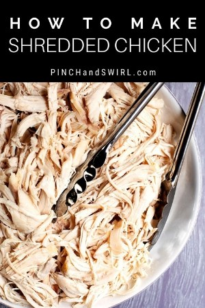 slow cooker shredded chicken served in a white bowl