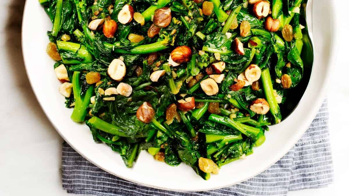 rapini with raisins and hazelnuts ready to serve