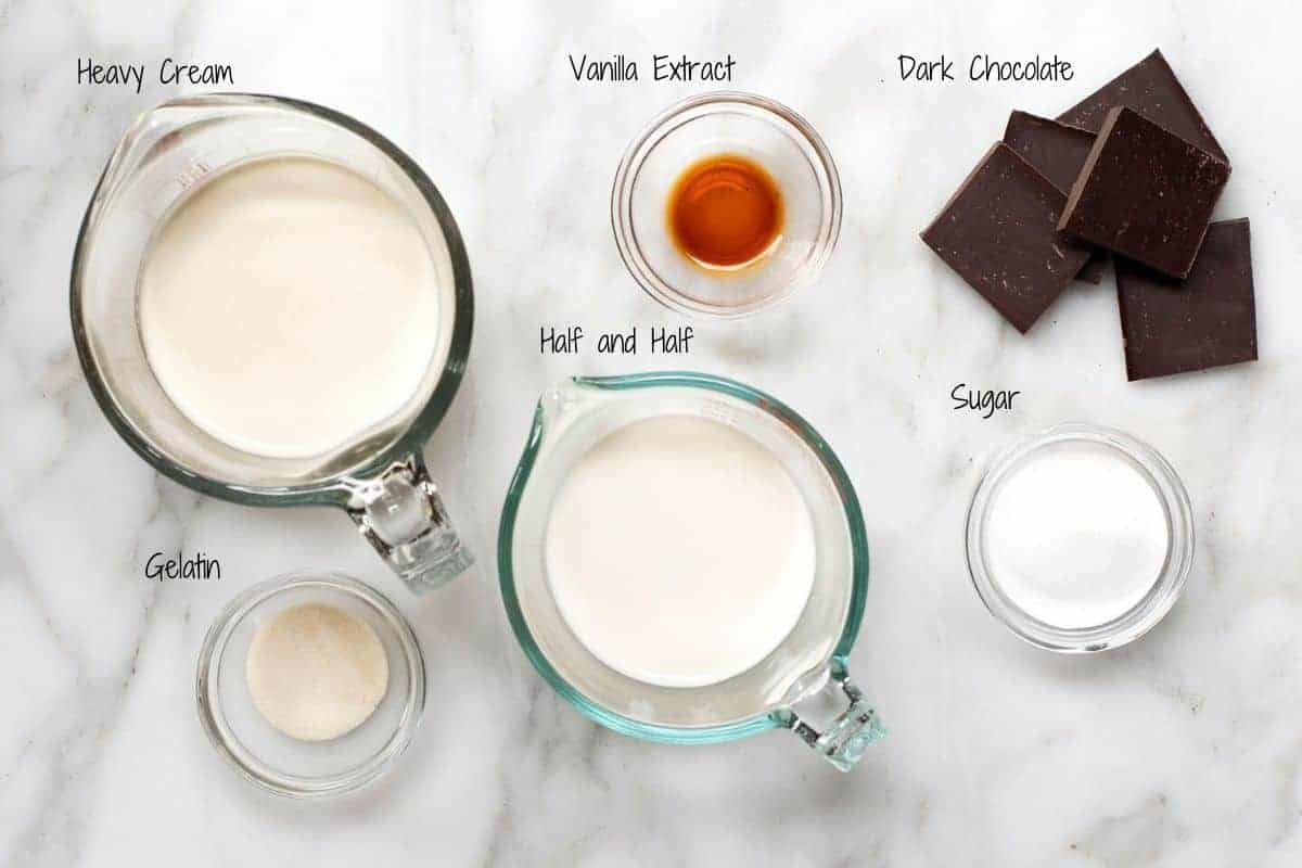 Chocolate Panna Cotta Ingredients on a white marble board