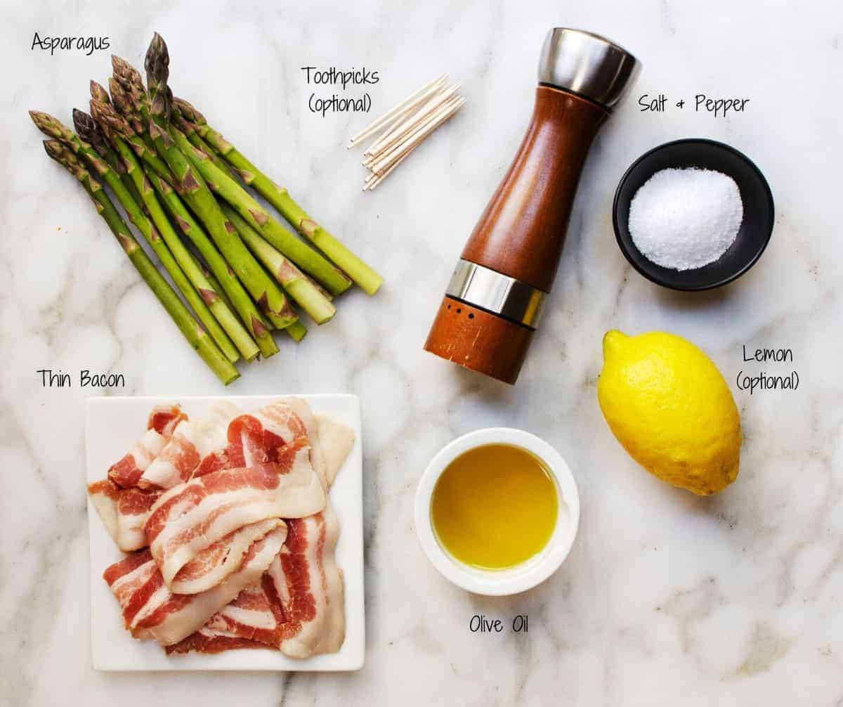 Ingredients for Grilled Bacon Wrapped Asparagus on a marble board