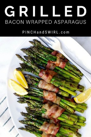 grilled bacon wrapped asparagus served on an oval platter