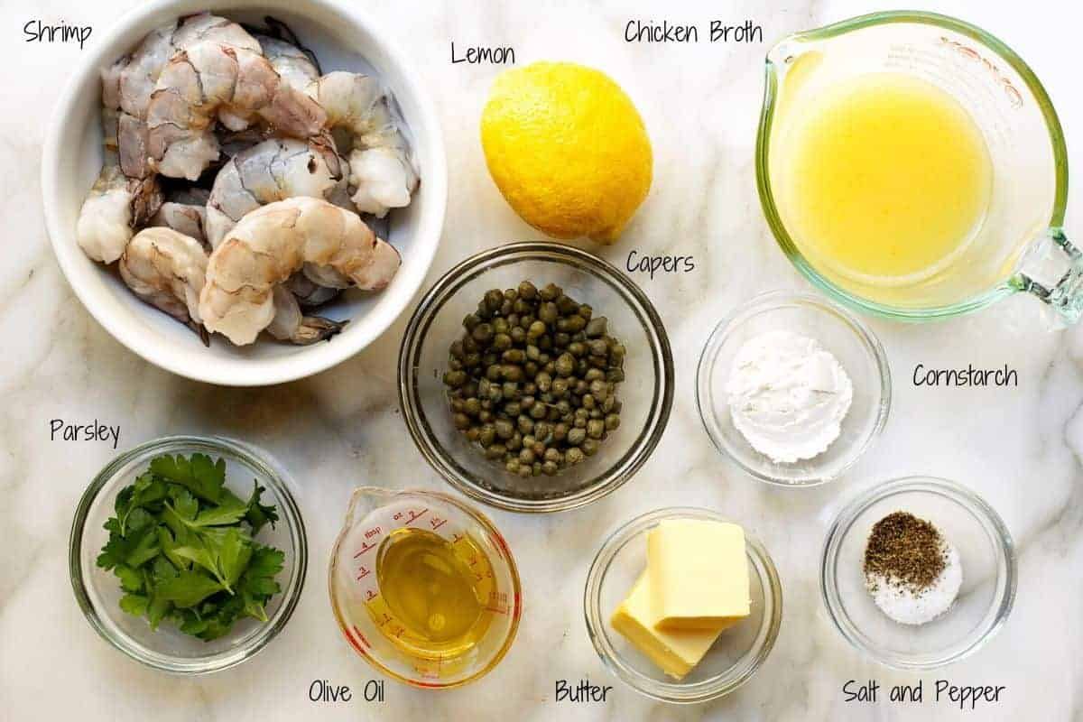 ingredients for shrimp piccata on a marble board