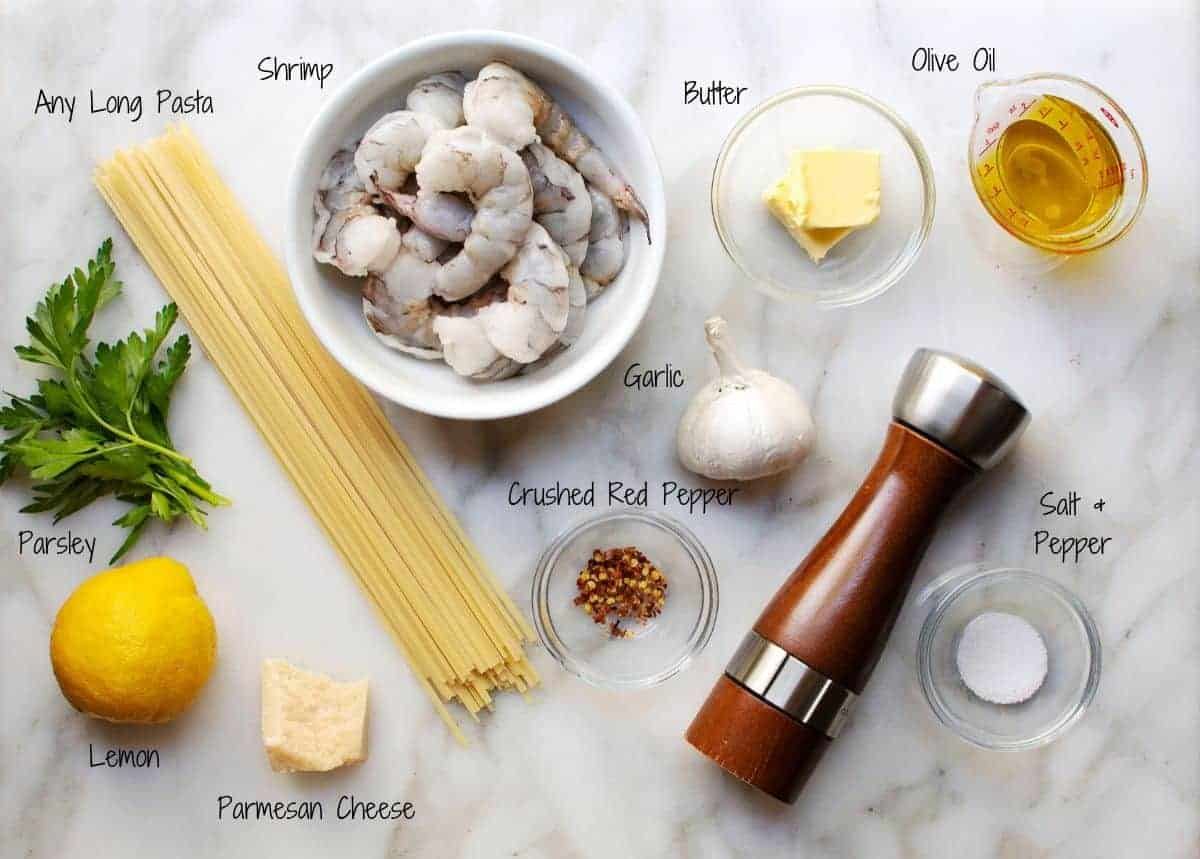 ingredients for Lemon Garlic Shrimp Pasta on a white marble surface