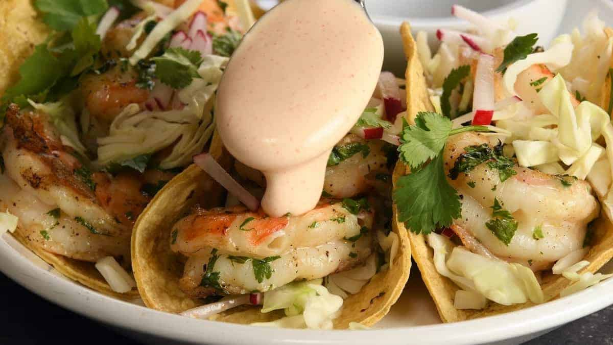 assembling grilled shrimp tacos