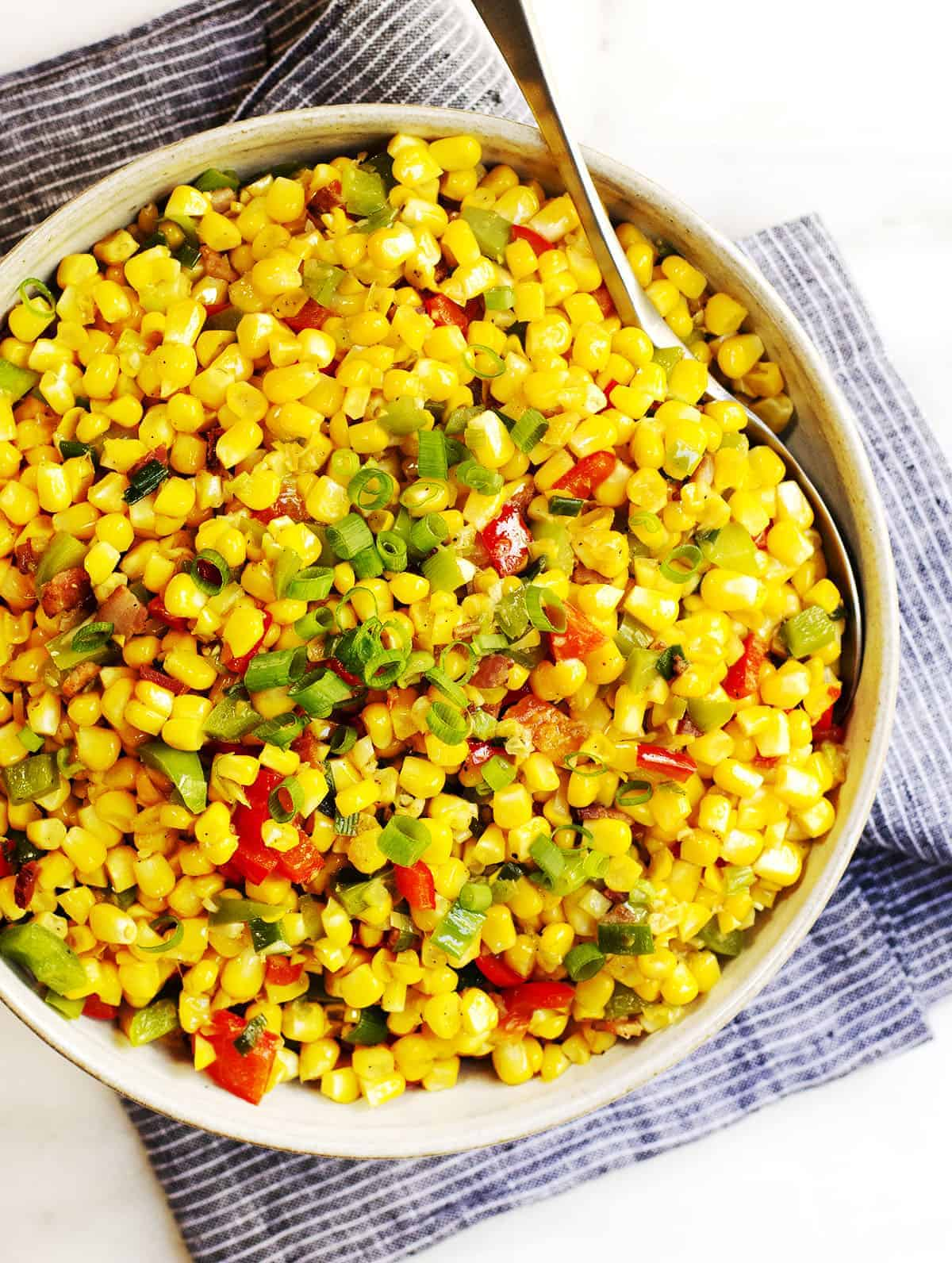 Corn Maque Choux served in a gray ceramic bowl photo from above