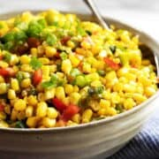 Corn Maque Choux served in a gray ceramic bowl