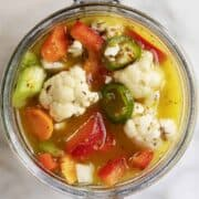 Giardiniera served in a glass canning jar