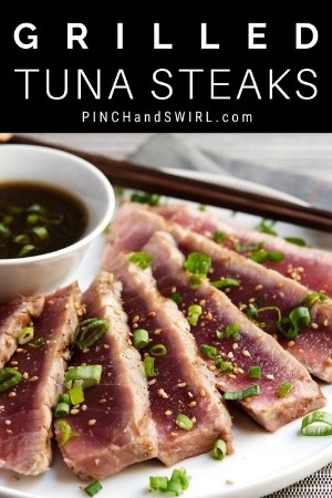sliced grilled tuna steaks on a round white plate