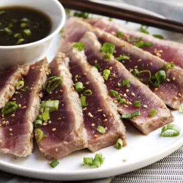 Grilled Tuna Steaks served on a white plate