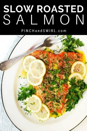 slow roasted salmon served on a white oval platter
