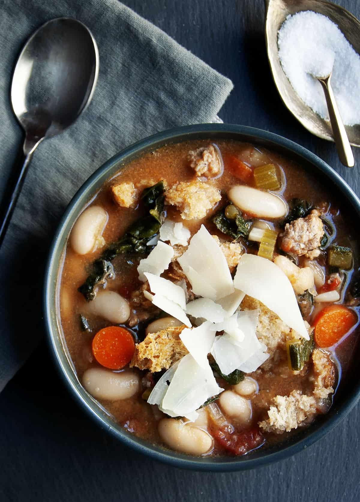 ribollita soup served a black bowl