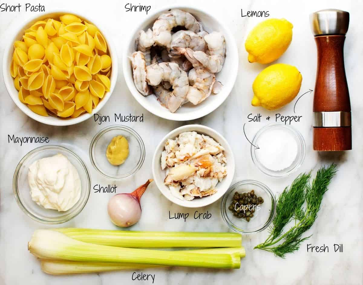 Seafood Pasta Salad ingredients on a white marble board