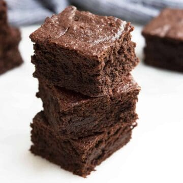 Almond Flour Brownies stacked on a white board