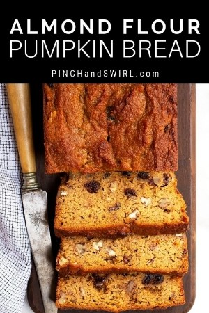 slices of almond flour pumpkin bread on a wooden board