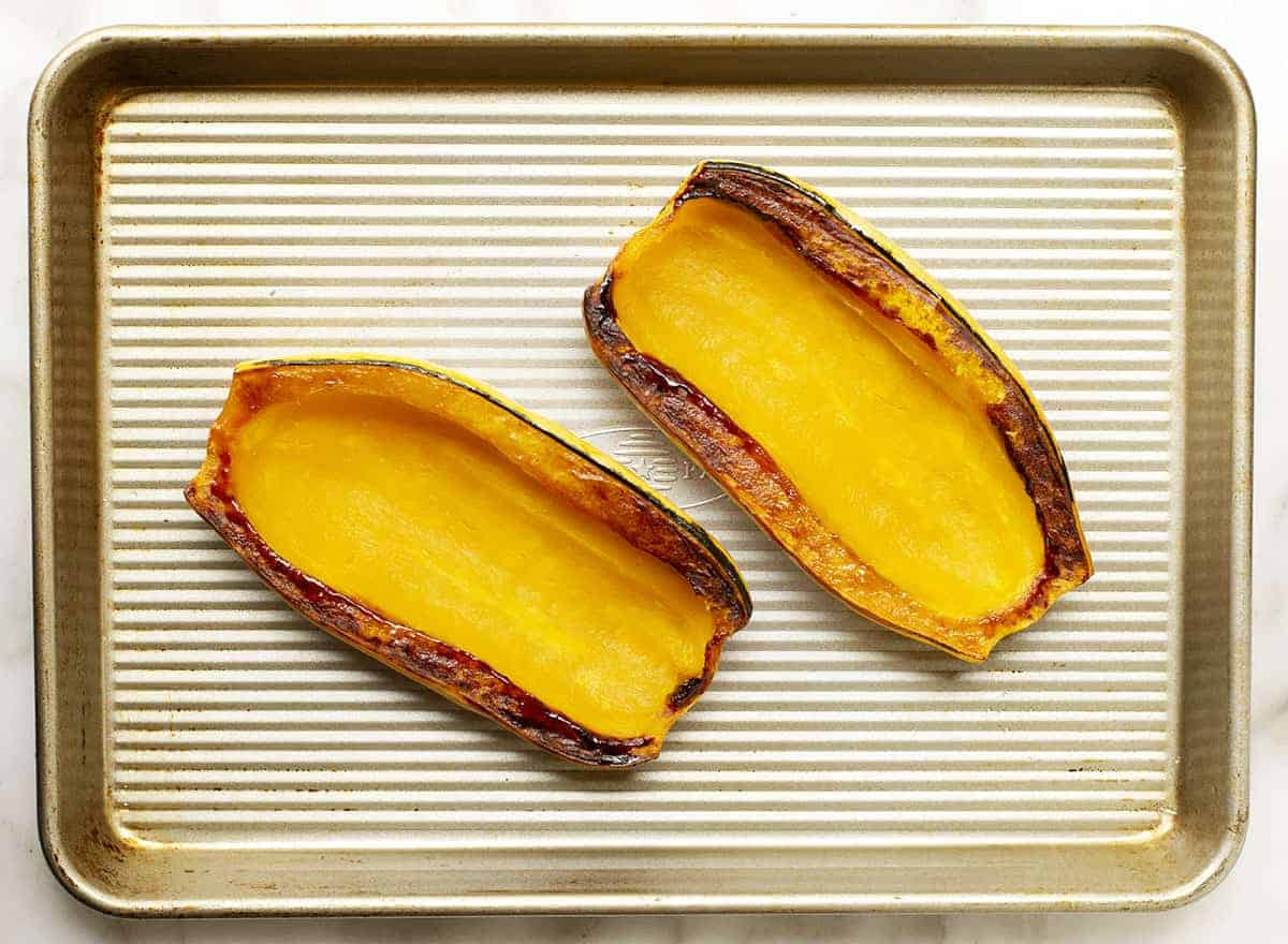 Roasted Delicata Squash Halves on Baking Sheet