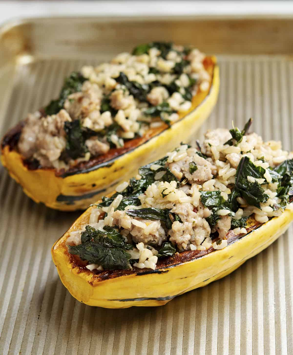 Stuffed Delicata Squash on Baking Sheet