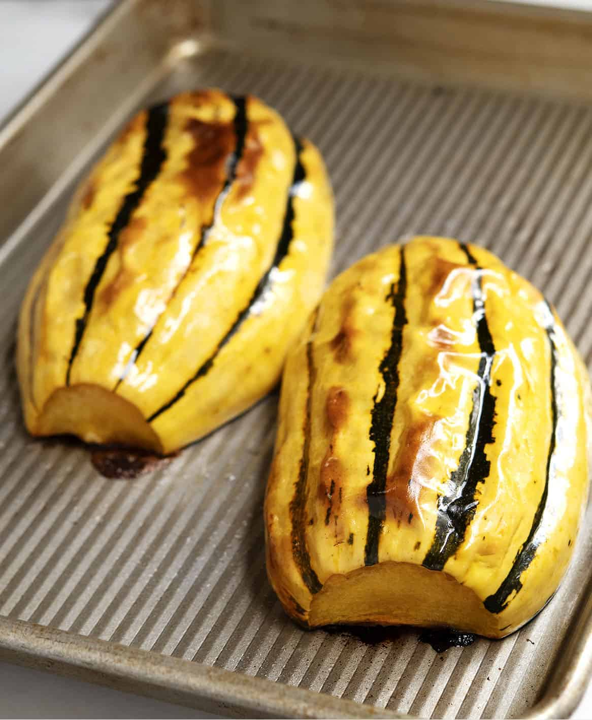 roasted delicata squash on baking sheet