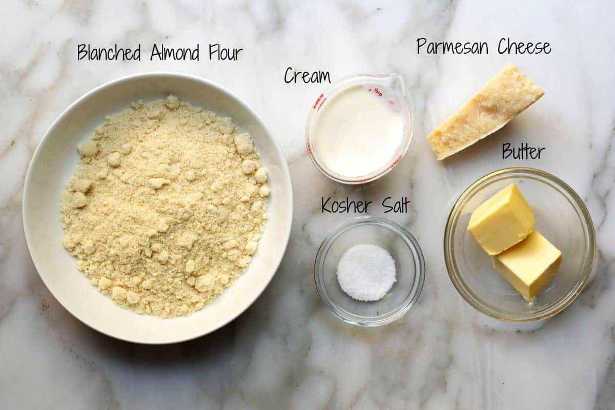 Almond Flour Crackers Ingredients on a white marble board