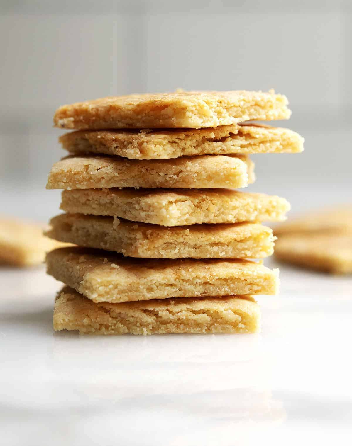 Almond Flour Crackers stacked on a white marble board