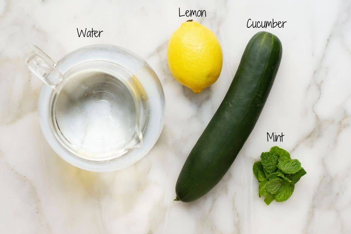 Cucumber Lemon Mint Water Ingredients on a white marble board