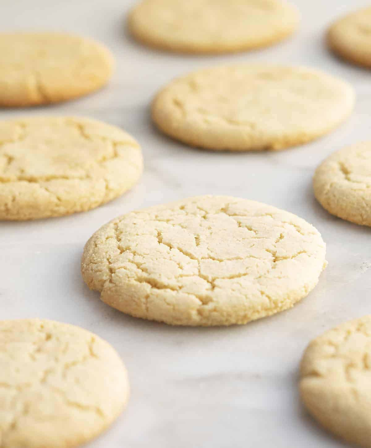 Cut Out Almond Flour Sugar Cookies on a white marble board
