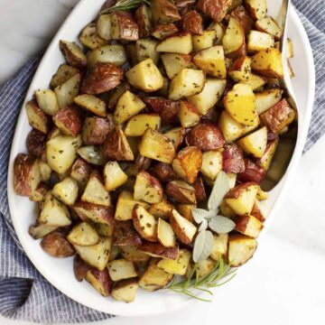 Italian Roasted Potatoes served on an oval white platter