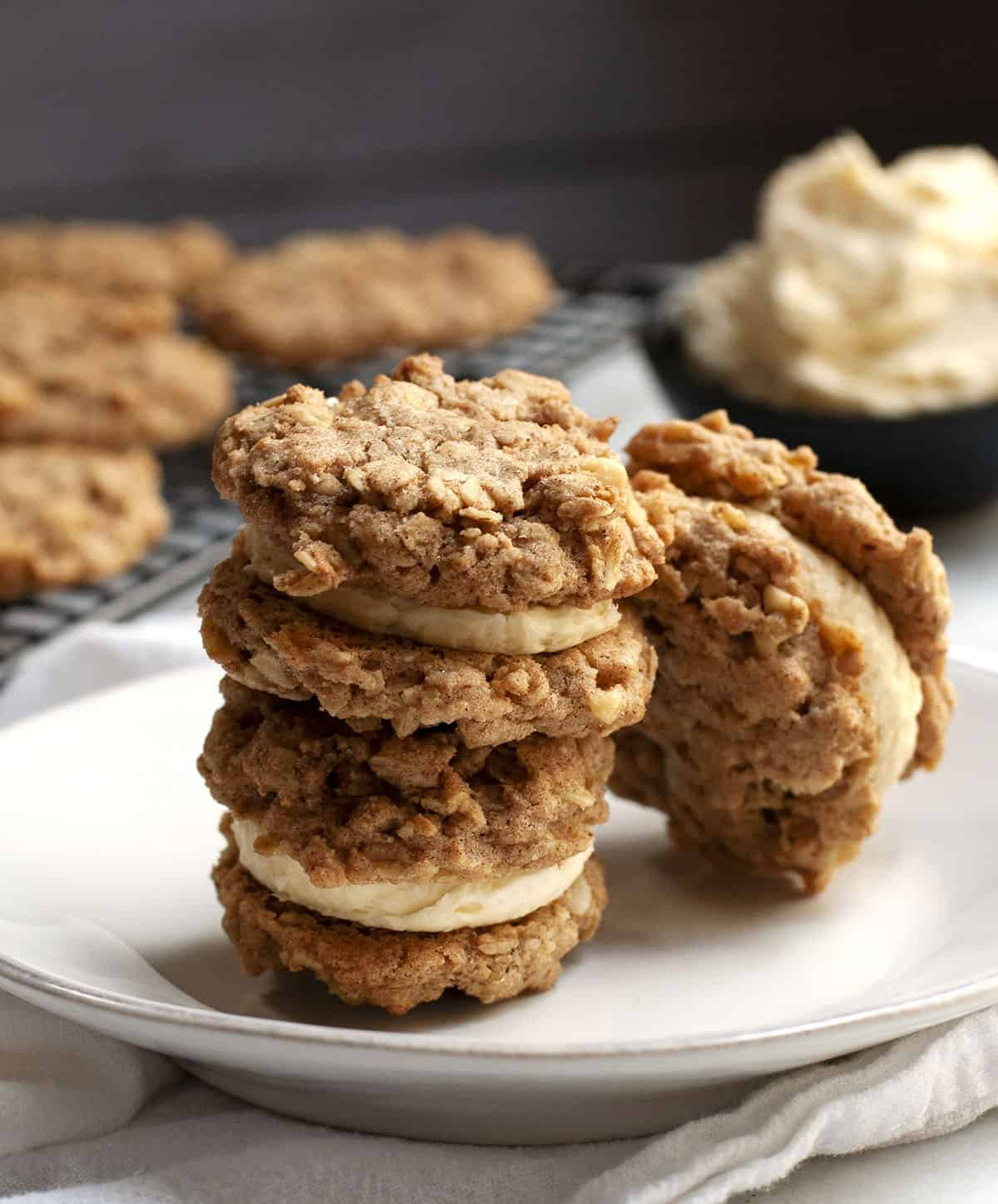 Oatmeal Sandwich Cookies stacked on a white plate