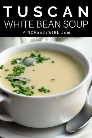 tuscan white bean soup served in a white ceramic bowl